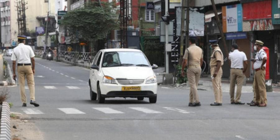 Police check on vehicles at MG road in Kochi as part of the the weekend restrictions issued by the state government
