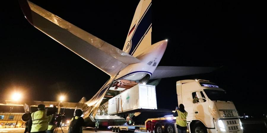 The Antonov 124, leaves Belfast with three 18-tonne oxygen generators and 1,000 quiescent fans, en route to India.