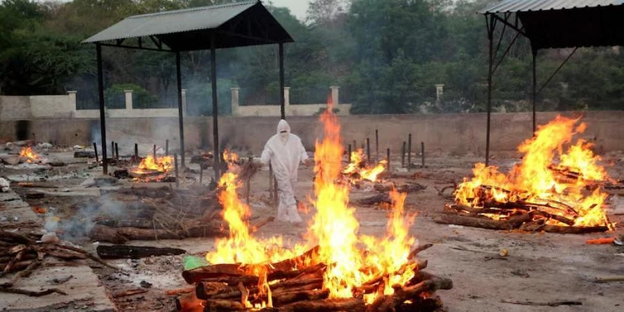 A Bhopal crematorium burns bodies in rows as the facilities get overwhelmed by the number of deaths.