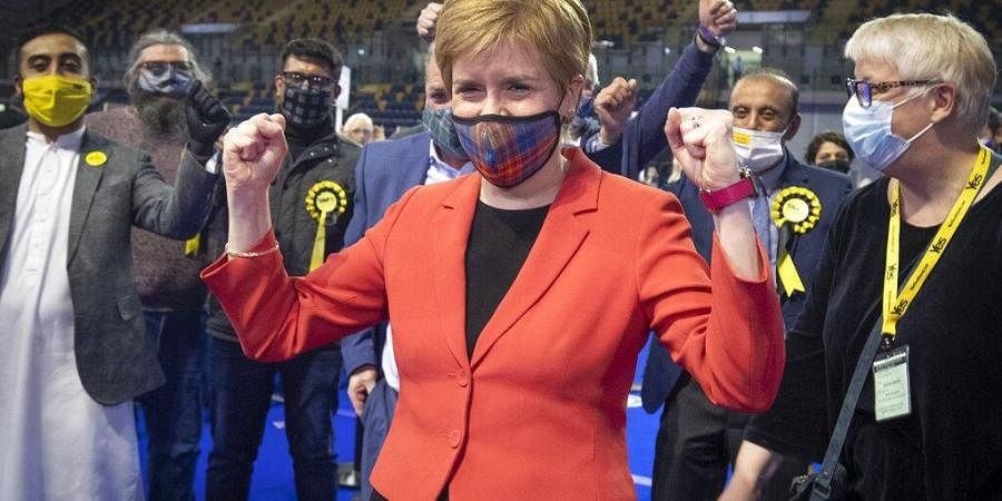 First Minister and SNP party leader Nicola Sturgeon celebrates after retaining her seat for Glasgow Southside at the count for the Scottish Parliamentary Elections