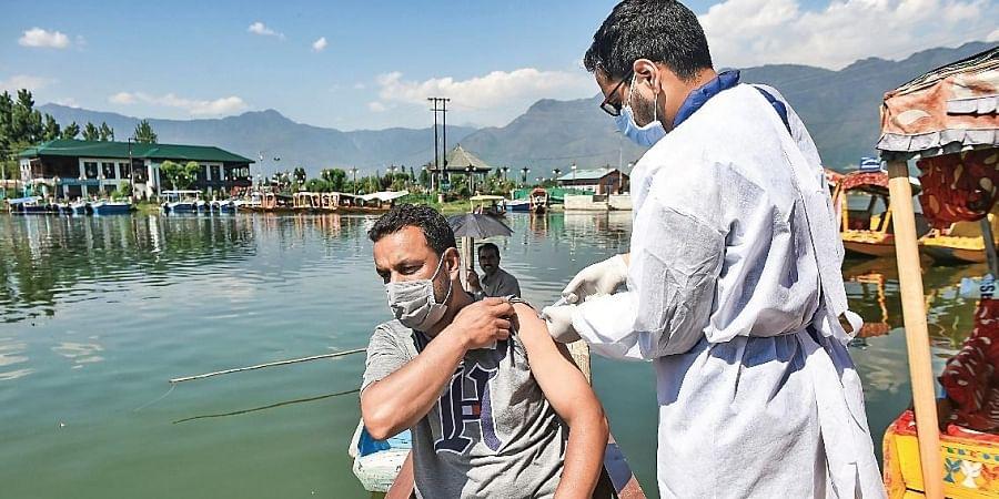 A shikarawalla gets vaccinated during a drive for boatmen in Srinagar.
