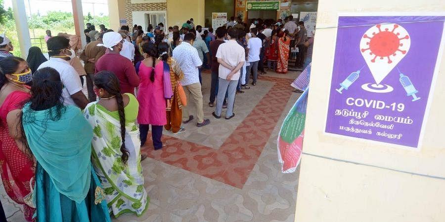 People waiting to receive Covid vaccine at Tirunelveli government medical college hospital. (Photo   V Karthikalagu, EPS)