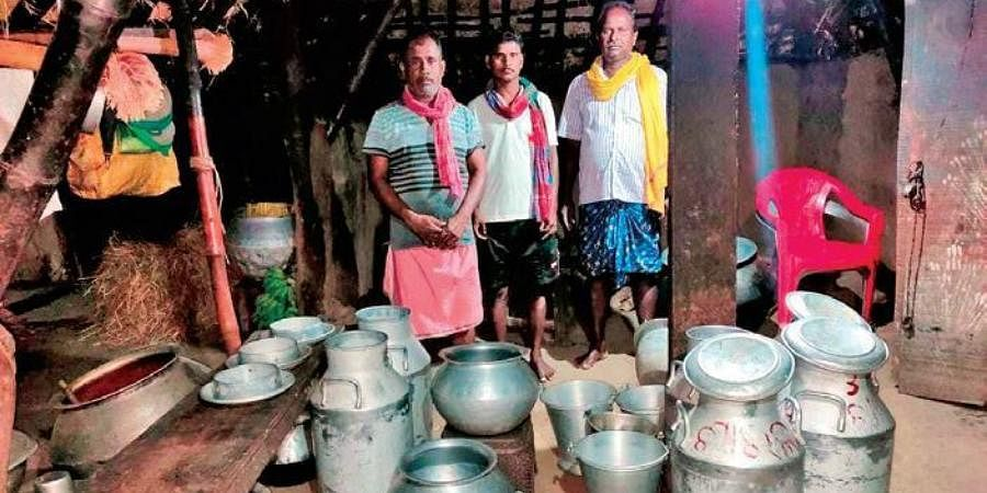 Dairy farmers with supplies of cottage cheese in Jagatsinghpur.