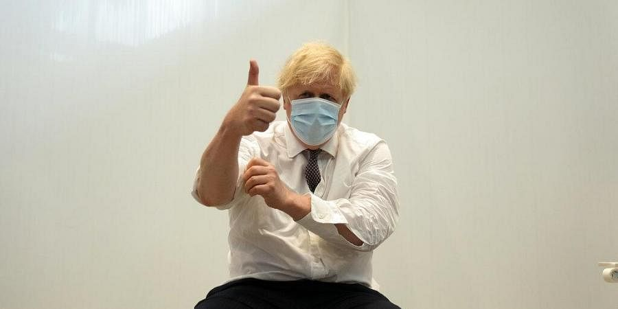 British Prime Minister Boris Johnson gives a thumbs up after receiving his second jab of the AstraZeneca coronavirus vaccine