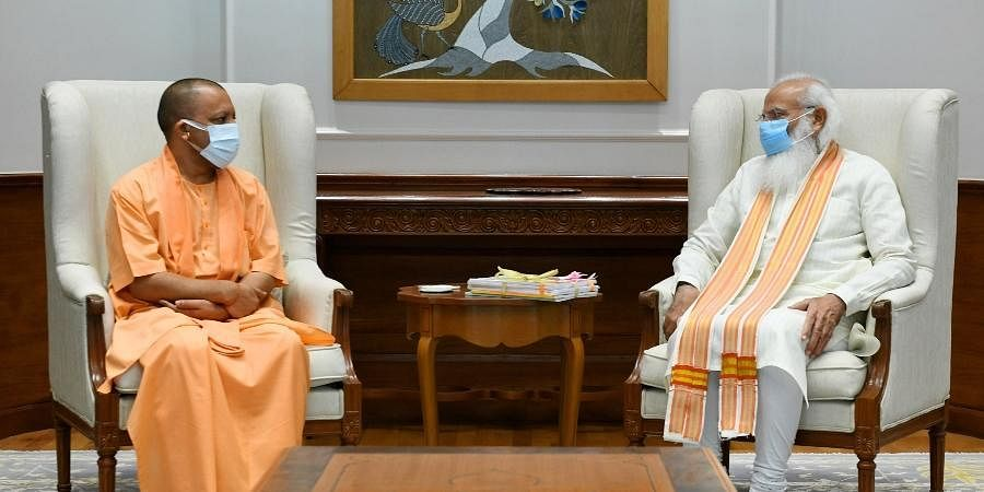 Uttar Pradesh Chief Minister Yogi Adityanath (L) with Prime Minister Narendra Mod.