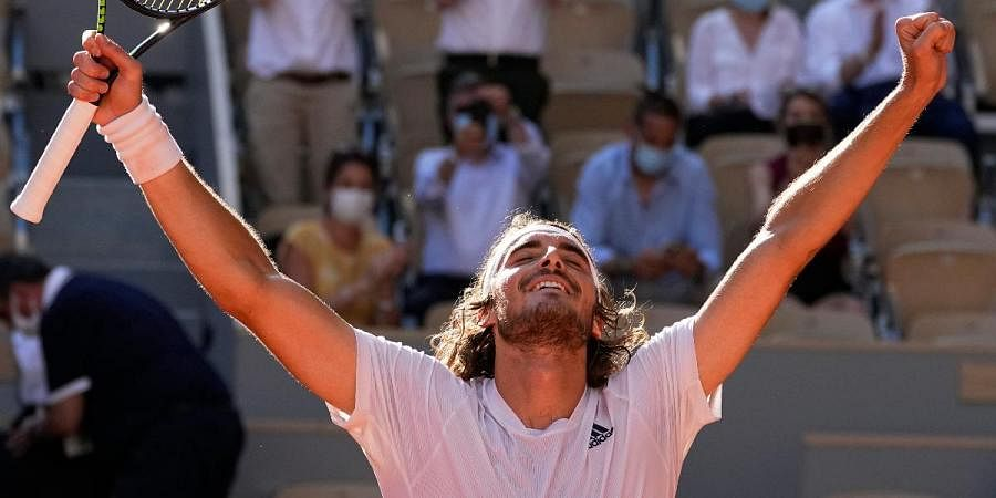 Stefanos Tsitsipas of Greece celebrates as he defeats Germany's Alexander Zverev during their semifinal match of the French Open tennis tournament