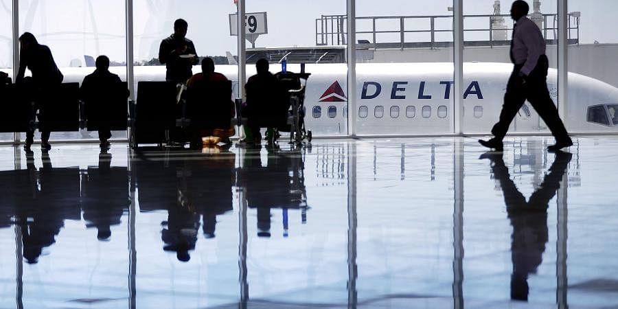 A Delta Airlines jet sits at a gate at Hartsfield-Jackson Atlanta International Airport, in Atlanta
