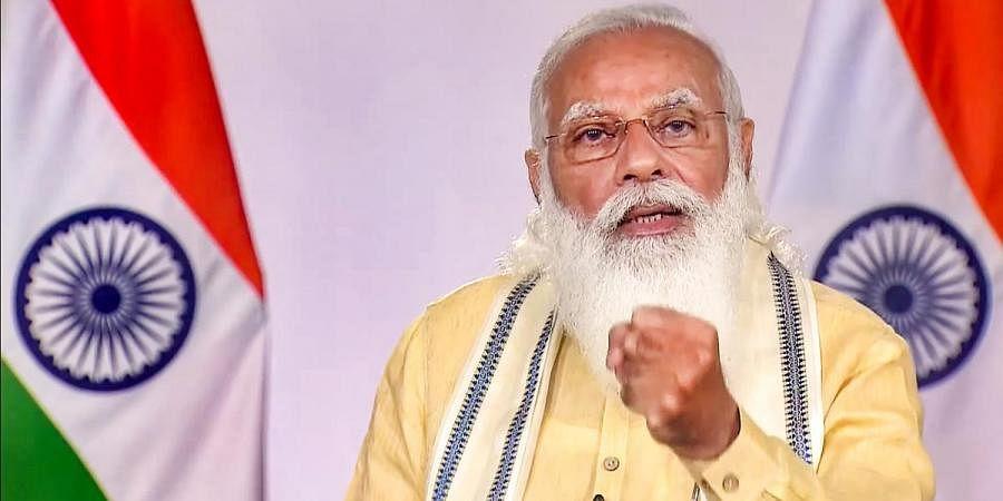 Prime Minister Narendra Modi addresses the nation, in New Delhi, Monday, June 7, 2021. (Photo | PTI)