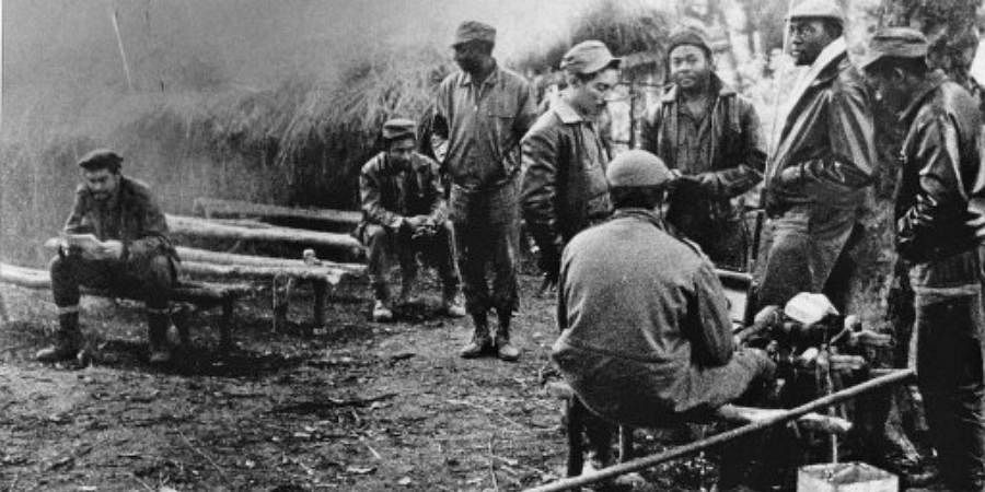 A 1965 photo depicts Cuban-Argentinian guerrilla Ernesto 'Che' Guevara (L) in a jungle camp of Congolese and Cuban soldiers involved in the guerilla movement in that country.