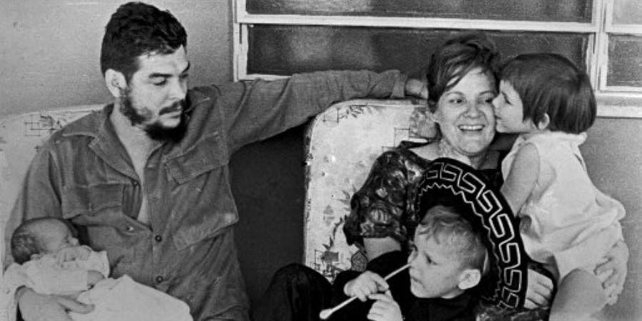 Picture taken on 60's of Argentine born guerrilla leader Ernesto 'Che' Guevara (L) with his son Ernesto Guevara March on his lap and his wife Aleida March playing with her son Camilo Guevara (C) and her daughter Celia Guevara.