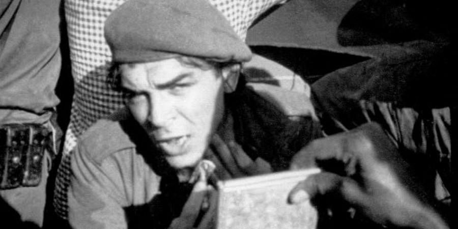 Picture taken 21 November 1965 of Argentine-born guerrilla leader Ernesto 'Che' Guevara (aka Tatu -number 3 in swahili) shaving on board a barge while crossing the Tanganika Lake from the then Congo Leopoldville (Belgian Congo) to Tanzania, during the withdrawal of forces after a failed campaign in Congo.