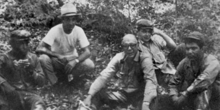 File picture taken in 1967 , showing probably Ernesto 'Che' Guevara disguised with almost no hair and glasses hidding with comrades near Nancahuazu in Bolivia as he was trying to organize the revolution in Bolivia.