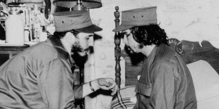 This 1959 file photo shows Cuban Fidel Castro (L), then 33 years old, chatting with ailing 31-year-old Ernesto 'Che' Guevara, at his barracks in Havana, shortly after both led the revolution that overthrew the Batista regime.