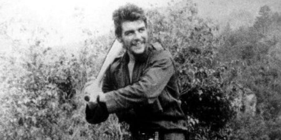 This 1958 file photo released by the Centro de Estudios Che Guevara shows legendary guerrilla Ernesto 'Che' Guevara taking batting lessons in Cuba's Sierra Maestra, one year before the success of the Cuban Revolution.