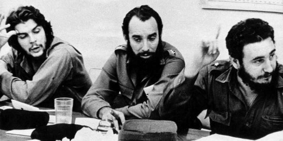 This 1960 file photo shows Cuban revolution hero Ernesto 'Che' Guevara (L) and Cap. Antonio Nunez Jimenez (C) listening to Fidel Castro (R) at a work meeting in Havana.