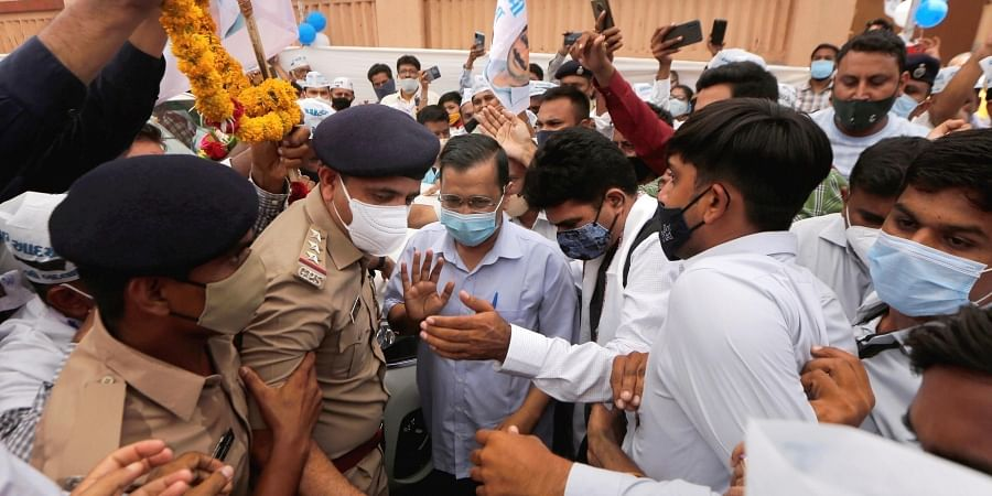 AAP party supporters welcome party chief and Delhi Chief Minister Arvind Kejariwal at new party office in Ahmedabad, Monday, June 14, 2021.