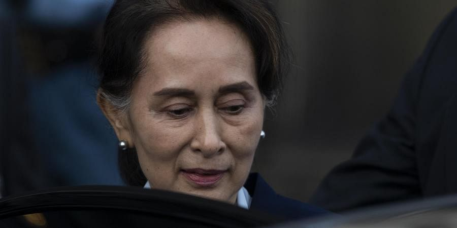 Myanmar's leader Aung San Suu Kyi leaves the International Court of Justice after addressing judges on the second day of hearing in Netherlands