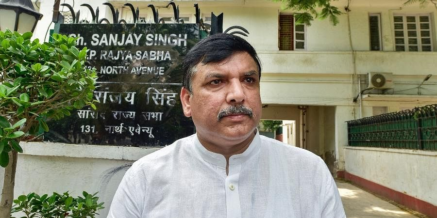 AAP MP Sanjay Singh outside his residence as Police said an attempt was made to deface the nameplate, in New Delhi, Tuesday