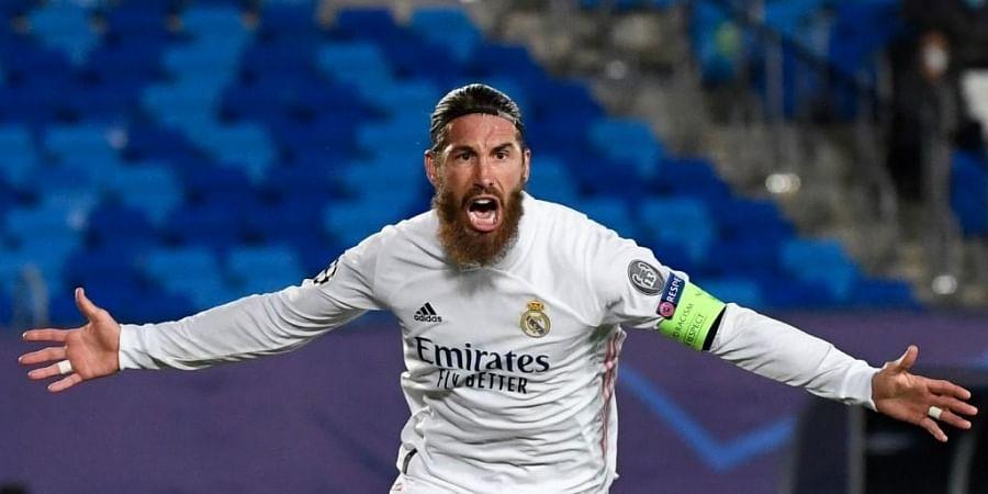 Real Madrid's Spanish defender Sergio Ramos celebrates his goal. (Photo   AFP)
