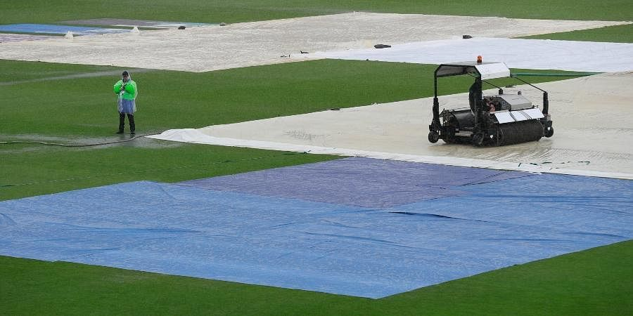 A super sopper is used to remove water after rain delayed start of the first day of the WTC final cricket match between New Zealand and India, at the Ageas Bowl in Southampton.