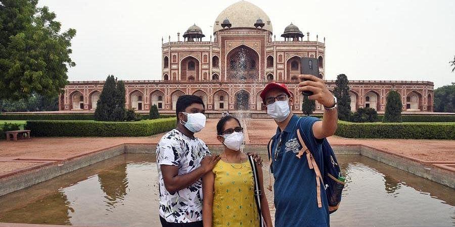 Vistors taking selfie in front of Humayun's Tomb in Delhi. (Photo   Parveen Negi, EPS)