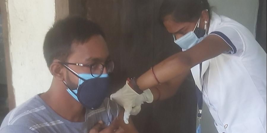 A youth being vaccinated in Bihar.