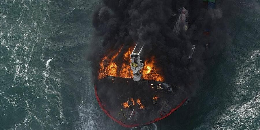 In this photo provided by Sri Lanka Air Force, smoke rises from the container vessel MV X-Press Pearl engulfed in flames off Colombo port, Sri Lanka. (Photo   AP)