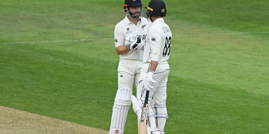 New Zealand's captain Kane Williamson (L) congratulates Devon Conway after he reaches his half century on 3rd day of WTC Final against India Ageas Bowl, Southampton, England on June 20, 2021.