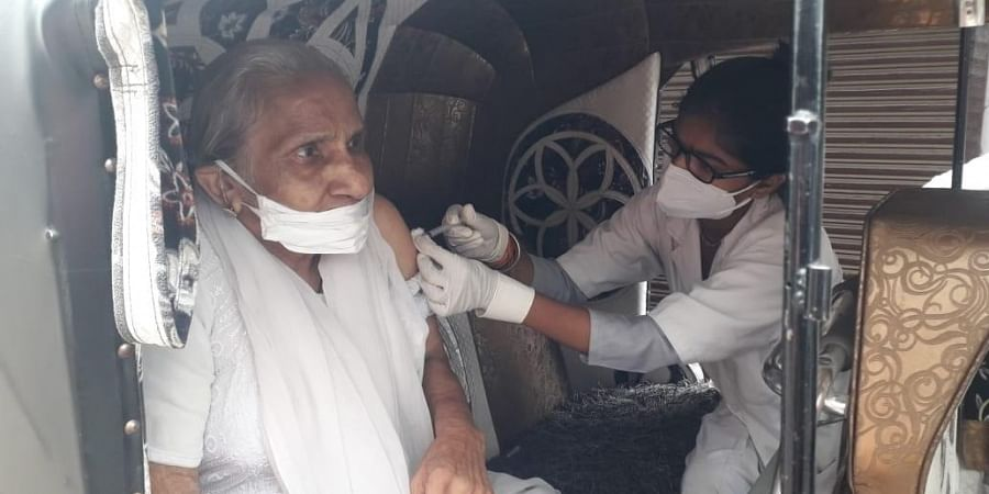 A medic administers a dose of COVID-19 vaccine to a woman in Madhya Pradesh on Monday.