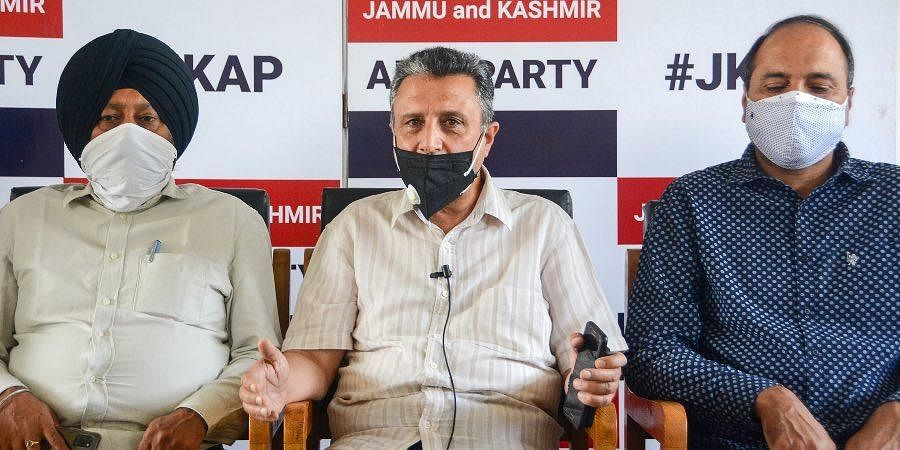 Jammu and Kashmir Apni Party General Secretary Rafi Ahmad Mir (C) along with senior party leaders address a press meet regarding the invitation to attend the All Party meeting called by the PM Modi in Delhi.