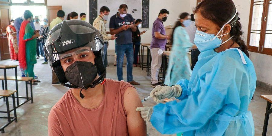A beneficiary receives a dose of Covid-19 vaccine at a vaccination centre in Jammu