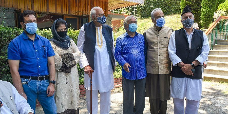 National Conference President Farooq Abdullah and PDP Chief Mehbooba Mufti with other members after a meeting of People's Alliance for Gupkar Declaration, in Srinagar