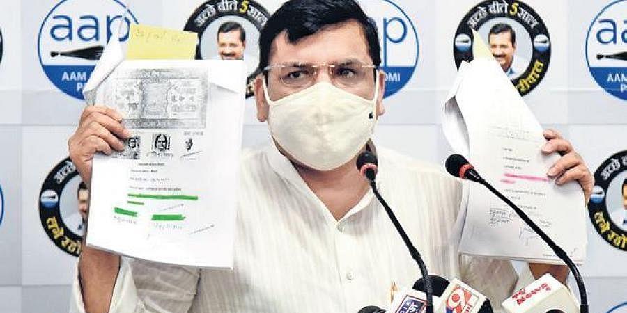 AAP leader Sanjay Singh addresses the press