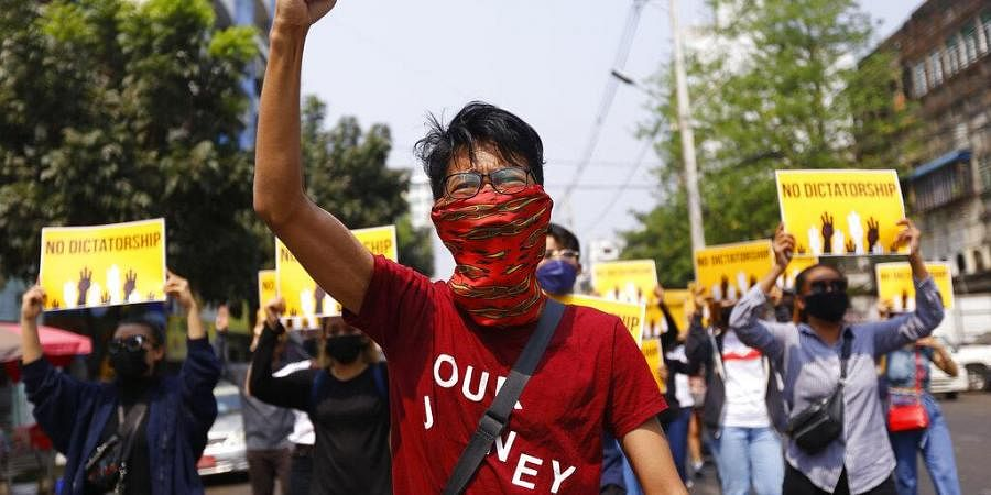 File photo anti-coup protesters gesture during a march in Yangon, Myanmar.