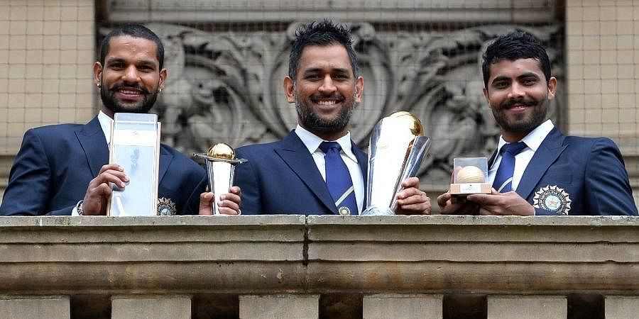 Indian cricketers Shikhar Dhawan (L), MSDhoni (C) and Ravindra Jadeja pose for pictures with the ICC Champions Trophy in Birmingham.