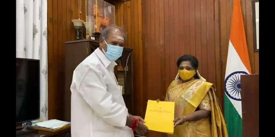 Puducherry CM N Rangasamy handing over the list of five MLAs to be inducted as ministers to Lieutenant Governor Dr Tamilisai Soundararajan. (Photo  Express)