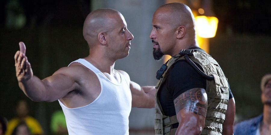 Hollywood actors Vin Diesel (L) and Dwayne Johnson