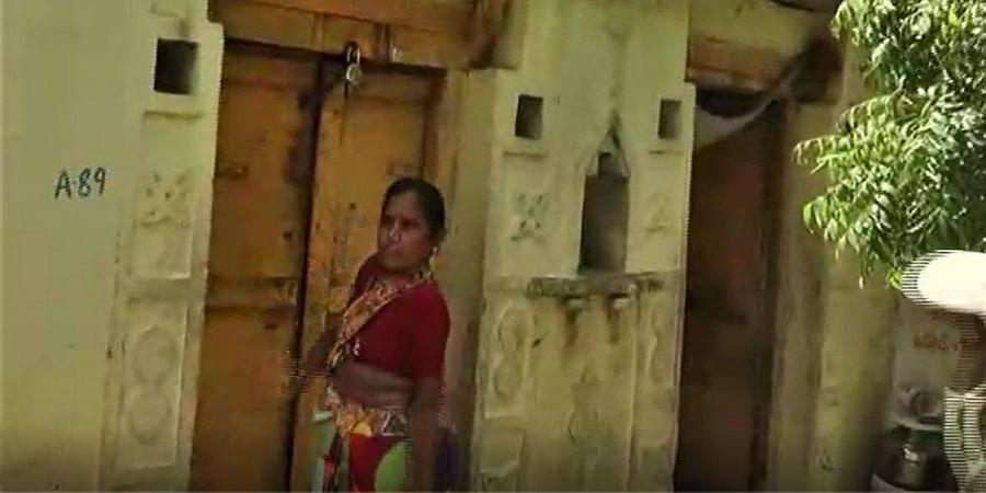 A woman locks up her house at Kenchagarahalli of Yadgir taluk