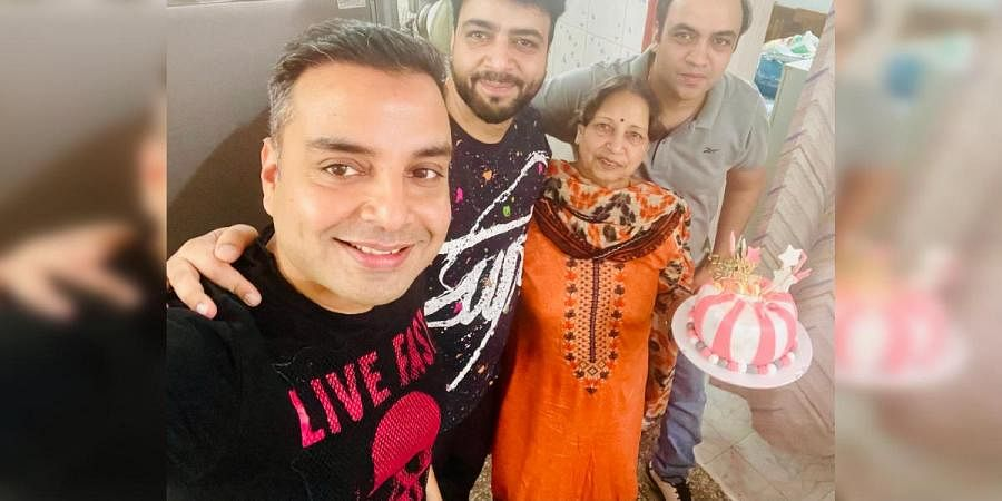 Vinay K Mayer celebrating with family and friends after having gotten his negative result