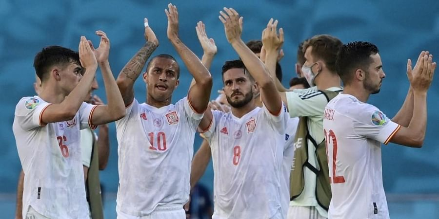 Spain's players celebrate their victory after the UEFA EURO 2020 Group E football match between Slovakia and Spain at La Cartuja Stadium in Seville on June 23, 2021.