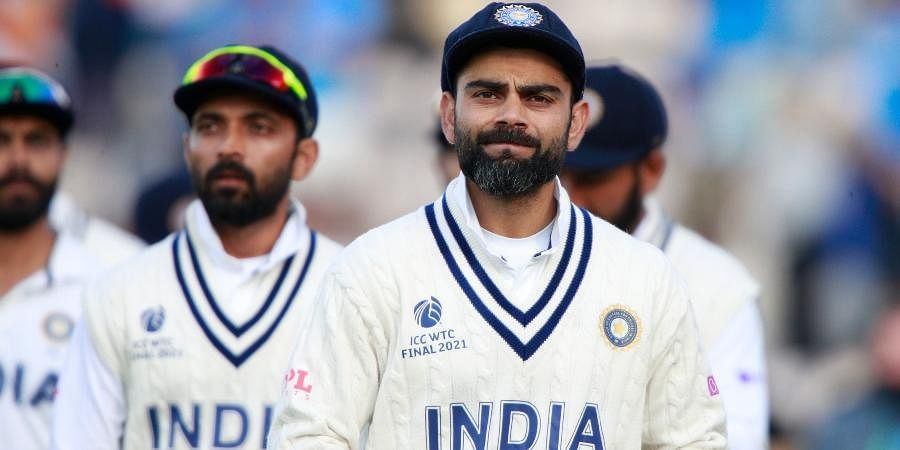 Indiacaptain Virat Kohli (R)reacts after their loss on the sixth day of the World Test Championship final between New Zealand and India, at the Rose Bowl in Southampton.