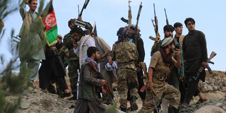 Afghan militiamen join Afghan defense and security forces during a gathering in Kabul