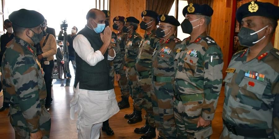 Union Defence Minister Rajnath Singh greets senior officials of the Indian Army on his arrival on a two-day visit, in Leh.