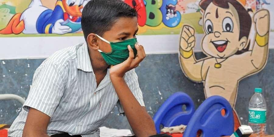 A boy admiited at a COVID-19 care centre, during the second wave of coronavirus epidemic in India