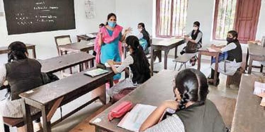 Students attend a class which operated with 50 per cent attendance.