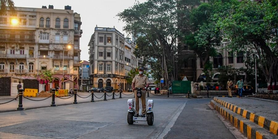 A police personnel patrols near the Gateway of India area in Mumbai (File photo | PTI)