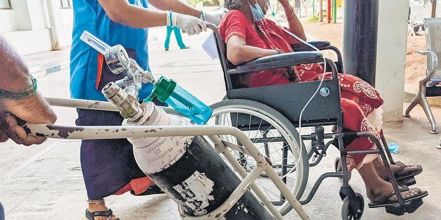 A patient on oxygen support being taken to Covid ward at Omandurar Hospital on Monday. (Photo | Debadatta Mallick, EPS)