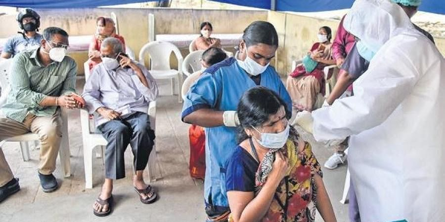 A woman takes the jab at Fever Hospital in Hyderabad as Covid vaccination drive resumed in the State on Tuesday