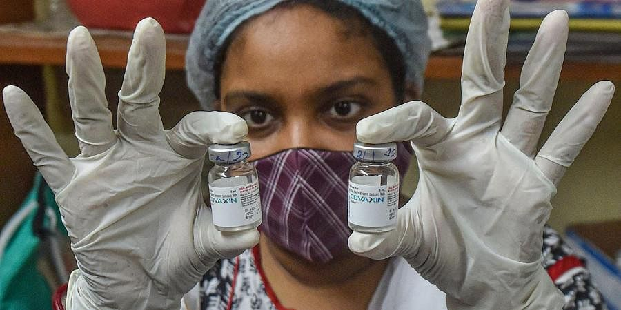 A health worker shows the vials fo Covaxin dose, at a vaccination centre in Kolkata. (Photo   PTI)