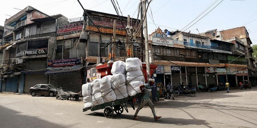 A worker pulls handcart during the lockdown imposed amid the rise in COVID-19 cases in New Delhi